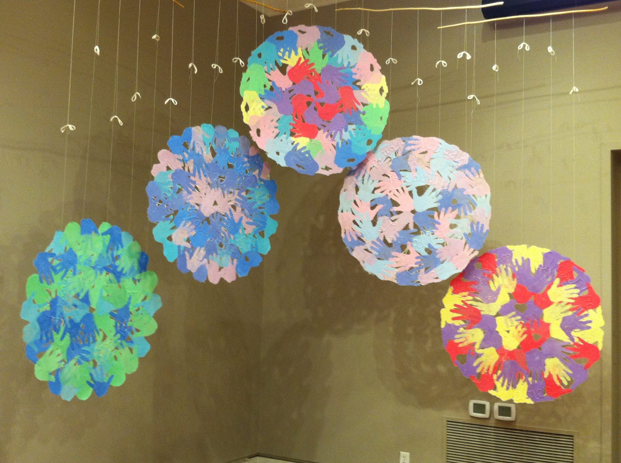 large round handmade paper pages suspended from ceiling