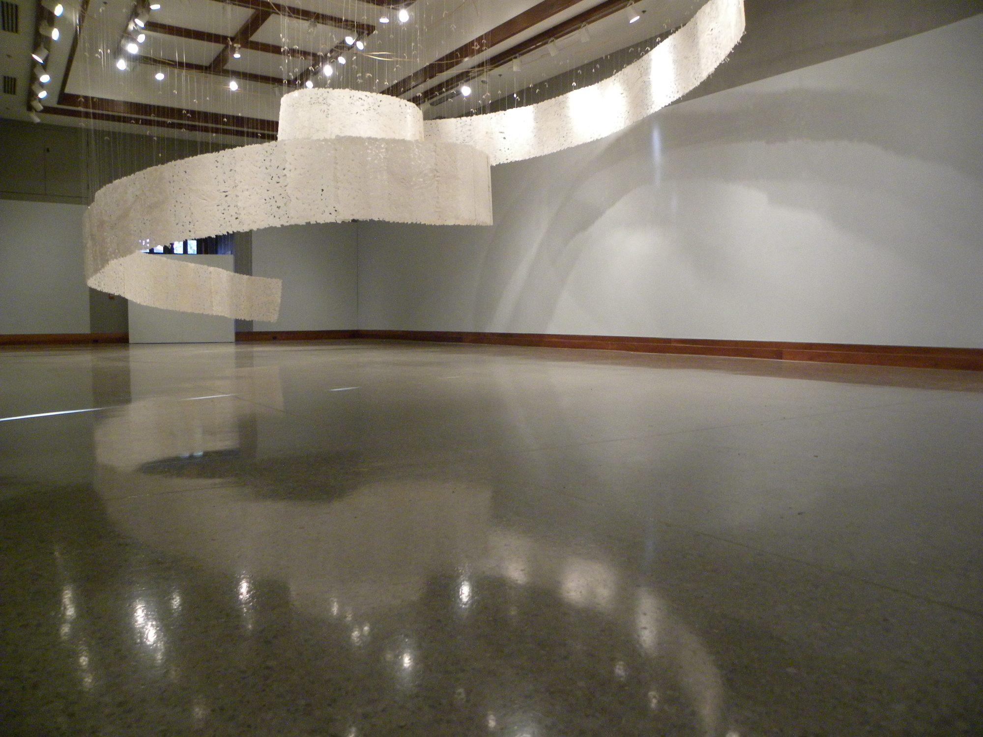 large handmade paper installation suspended from 20 foot ceiling
