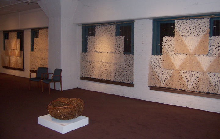 large handmade paper suspended in the windows