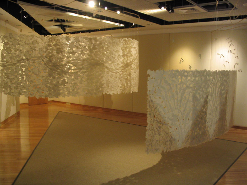large handmade paper installation suspended from ceiling