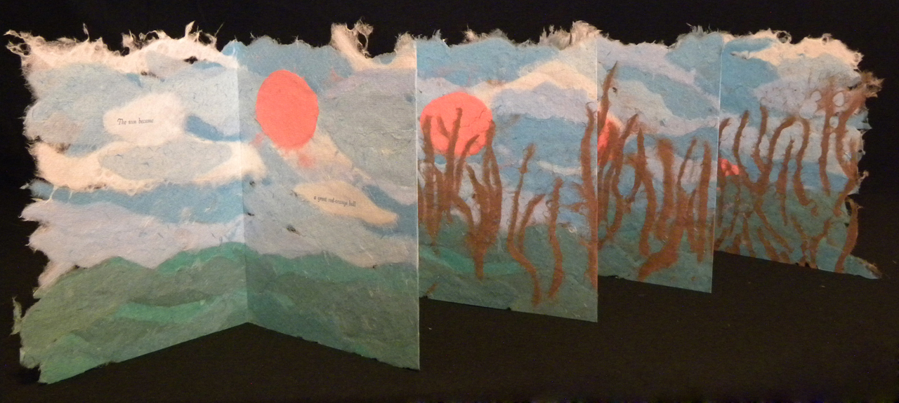 small artists' book with sunset