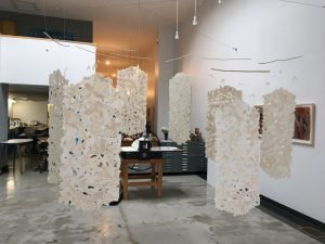 detail, large handmade paper installation suspended from the ceiling