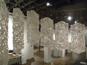 large handmade paper installation suspended from the ceiling